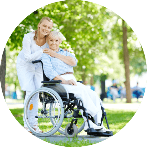 caregiver and old woman in wheelchair